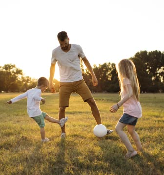 Dad and kids playing soccer