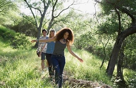 Young adults walking on a trail