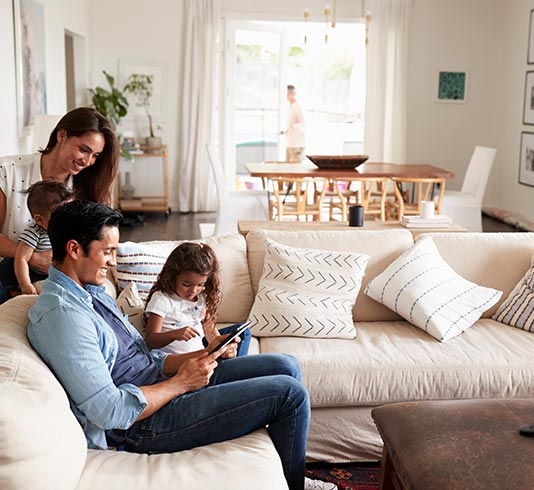 Young family hanging out on the couch