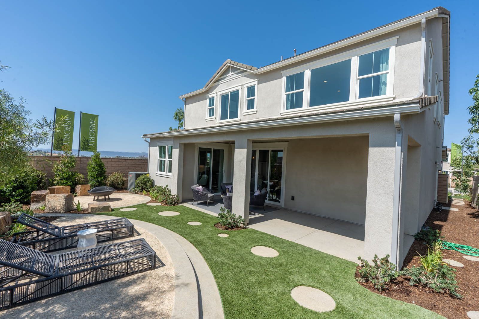 Backyard with Covered Patio in Alsbury at Arborly at Sommers Bend