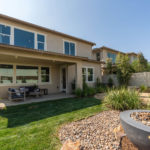 Backyard with Covered Patio in Finch at Canvas at Sommers Bend