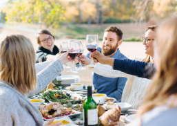 friends toasting at a table outdoors