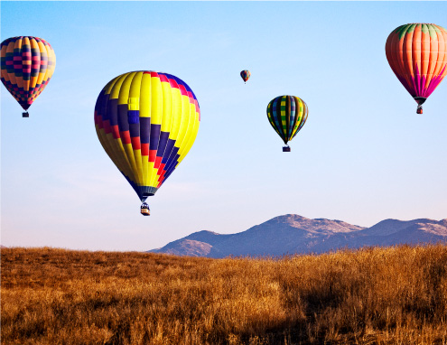 Hot air Balloons Flying over Skinner Lake in Temecula California