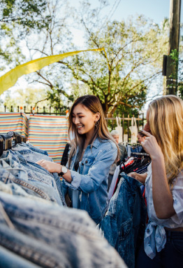 two women jean jacket shopping outdoors